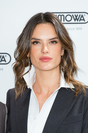 Alessandra Ambrosio looked fabulous with her face-framing wavy 'do at the Rimowa store opening in London.