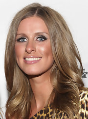 Nicky Hilton added a subtle shimmer to her bronzed look with silver shadow on her upper lids.