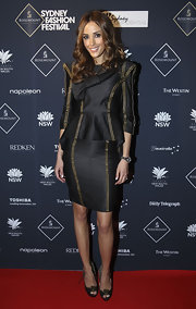 Rebecca paired her black day dress with peep toe pumps and sheer tights.
