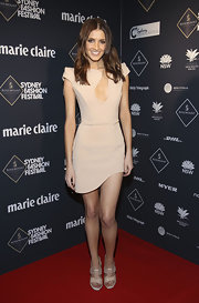 Kate Waterhouse perfectly paired her nude sandals with a cut out nude cocktail dress.