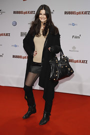 Shermine Shahrivar stepped out at the 'RubbleDieKatz' premiere wearing a stylish cardigan.