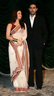 Aishwarya Rai looked phenomenal in a sheer white and maroon sari with gold embellishments.