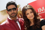 Abhishek Bachchan wore modern rectangular sunglasses with his red leather jacket for an extra cool finish at the 'Raavan' photocall.