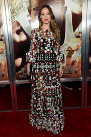 Olivia Wilde hovered between sweet and sultry in this sheer floral-embroidered gown by Dolce & Gabbana at the New York screening of 'Race.'
