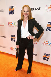 Marg Helgenberger paired a black suit with a white wrap top for the Race to Erase MS Gala.