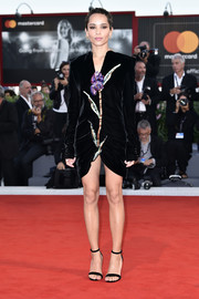 Zoe Kravitz looked supremely elegant in a floral-embroidered velvet dress by Saint Laurent at the Venice Film Festival premiere of 'Racer and the Jailbird.'
