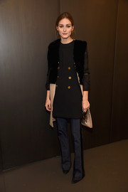 Olivia Palermo layered a black and nude fur-accented coat over a gold-buttoned top for the Rachel Zoe presentation.