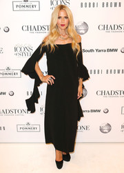 Rachel Zoe was all about breezy elegance at the Icons of Style launch in a black off-the-shoulder dress with draped ruffles extending from the sleeves.