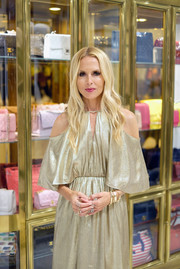 Rachel Zoe complemented her gown with multiple gold bangles when she attended the Rachel Zoe x What Goes Around Comes Around pop-in.