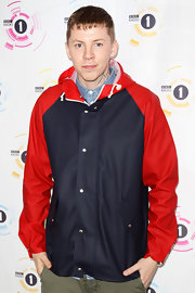 Professor Green was a bright sight at Radio 1's 2011 Big Weekend in his red and black raincoat.