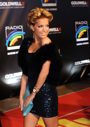 Silvie Van Der Vaart added some more fabulous retro style to her look with a cropped black fur coat.