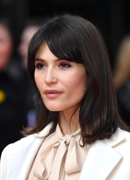 Gemma Arterton wore her hair down to her shoulders in a flipped style with parted bangs at the UK premiere of 'Radioactive.'