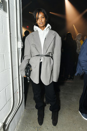 Liya Kebede sealed off her outfit with a pair of slouchy black slacks.