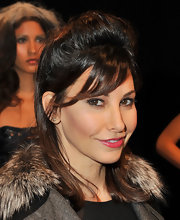 Gina Gershon wore her voluminous 'do with side-swept bangs in front and long sleek strands in back at the Rafael Cennamo presentation.