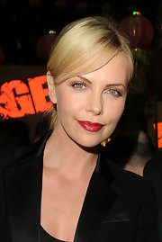 Charlize Theron went for a ruby red pout at the Rage Official launch party. To try her look,  we recommend a classic red like NARS Lipstick in Jungle Red or Covergirl LipPerfection Lipcolor in Hot (warm) or Tempt (cool).
