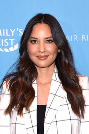 Olivia Munn sported loose center-parted waves at the Raising Our Voices event.