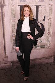 Anne Hathaway ditched the dress in favor of this black tuxedo when she attended the Ralph Lauren fashion show.