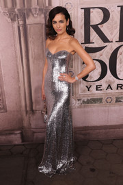 Camilla Belle went for high-octane glamour in a strapless silver gown by Ralph Lauren during the brand's fashion show.