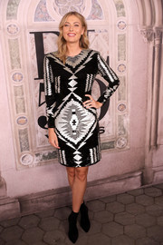 Maria Sharapova looked modern in a geometric-patterned dress by Ralph Lauren during the brand's fashion show.