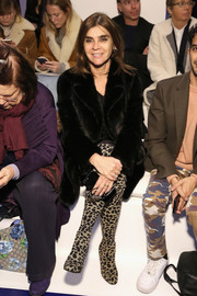 Carine Roitfeld teamed her coat with a pair of animal-print boots.