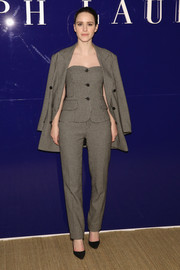 Rachel Brosnahan went matchy-matchy in this gray Ralph Lauren jacket, trousers, and bustier ensemble for the label's Fall 2018 show.