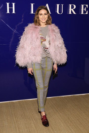 Olivia Palermo frilled up her look with a pink feather cape.