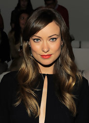 Olivia Wilde took a slight detour from the classic red-lipped trend when she attended the Ralph Lauren Spring 2012 fashion show. Instead, her lips were a vibrant, orange-red. To try her look, we recommend a shade like NARS Lipstick in Heat Wave.