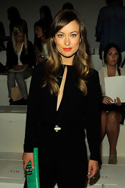 Olivia Wilde looked incredibly chic at the Ralph Lauren Spring 2012 fashion show. Her long, wavy locks can be recreated by curling three-inch sections of hair, lightly brushing to smooth the waves and spritzing with a sheer-hold hairspray.