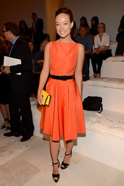 Olivia Wilde was a doll at the Ralph Lauren Spring 2013 show wearing this crisp taffeta orange number with a yellow citrus clutch.
