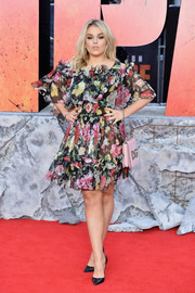 Tallia Storm was all abloom in a cold-shoulder floral dress at the European premiere of 'Rampage.'