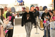 Savannah Chrisley headed to the Rampage x Savannah Chrisley event wearing a black faux-fur jacket from the collection.
