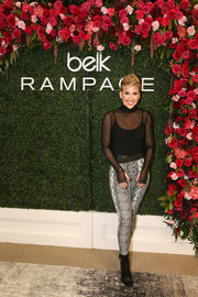 Black ankle boots finished off Savannah Chrisley's edgy attire.