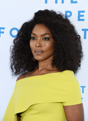 Angela Bassett looked downright fab with her voluminous shoulder-length curls at the Rape Foundation brunch.
