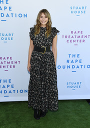 Elizabeth Olsen charmed in a printed maxi dress with ruffled sleeves at the Rape Foundation brunch.