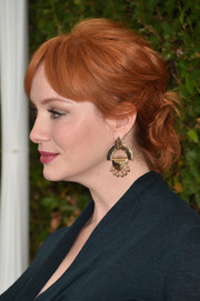 Christina Hendricks styled her hair into a knotted updo for the Rape Foundation's annual brunch.