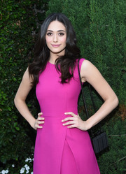 Letting her magenta dress stand out, Emmy Rossum accessorized with a simple black chain-strap bag by Christian Louboutin at the Rape Foundation's annual brunch.