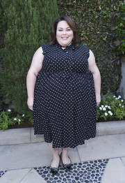 Chrissy Metz coordinated her dress with a pair of pearl-embellished flats.