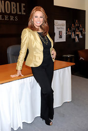 Raquel Welch looked chic wearing a satin blazer at the autograph signing of her book, 'Raquel: Beyond the Cleavage.'