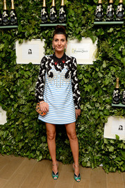 Giovanna Battaglia cut a vibrant figure in a crystal-embellished, mixed-print mini dress at the Raspoutine Paris Pop-Up event.