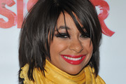 Raven-Symone Medium Straight Cut with Bangs