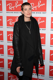 Agyness Deyn paired her black shirt with a leather trench coat.