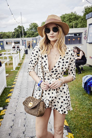 Laura Whitmore looked cute in a printed beige wrap top at the 2019 All Points East Festival.