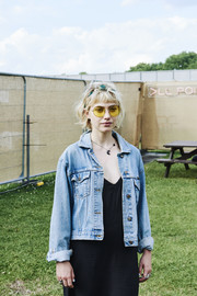 Imogen Poots went rugged in a blue denim jacket at the All Points East Festival.
