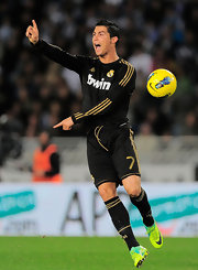 Cristiano rocked the field in a black and gold Real Madrid jersey.
