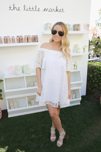 Lauren Conrad was summer-glam in a white lace off-the-shoulder dress by Rebecca Minkoff during the brand's 'See Now, Buy Now' fashion show.