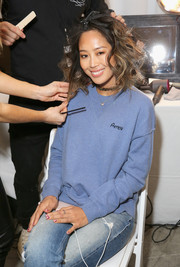 Aimee Song wore a personalized blue sweater while having her hair done for the Rebecca Minkoff 'See Now, Buy Now' fashion show.