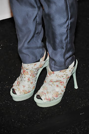 Mena's floral platform sandals would be lovely with a spring frock—not sure, though, about those black tights and slacks!