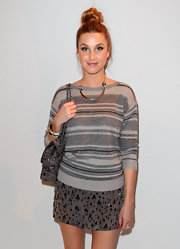Whitney donned a striped gray sweater paired with a chic cuff bracelet at the Rebecca Taylor show.