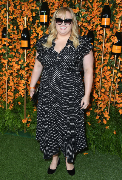 Rebel Wilson Print Dress [clothing,dress,eyewear,carpet,footwear,day dress,flooring,event,pattern,glasses,arrivals,rebel wilson,los angeles,pacific palisades,california,will rogers state historic park,veuve clicquot polo classic]
