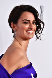 Penelope Cruz oozed glamour wearing this side chignon with wavy tendrils at the 2018 Cesar Film Awards.